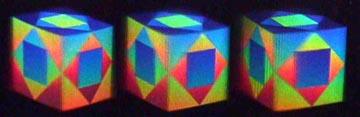 "Three  stereoscopic  views  of  ""Cube""  –  a  3D  multi-colour  dot-matrix hologram"